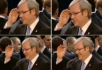 """Mr Rudd was briefly standing alone at the gathering of leaders from 26 countries when he saw Mr Bush, saluted, and strode over, smiling widely, to talk to the US President."""