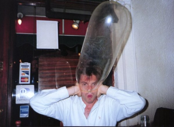 condom-being-inflated-over-mans-head