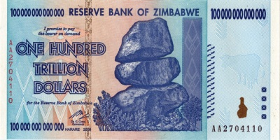 a real Zimbabwe 100 trillion dollar bill - that's a one and 14 zeros - a large quantity of them might buy a single US dollar.