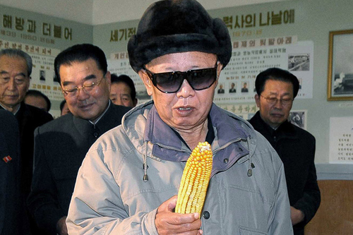 Kim Jong Il looks at corn as DPRK functionaries look at him