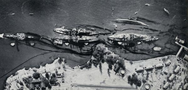 aerial photo of Pearl Harbor battleships Arizona, West Virginia, Tennessee, Maryland and Oklahomaoil slick